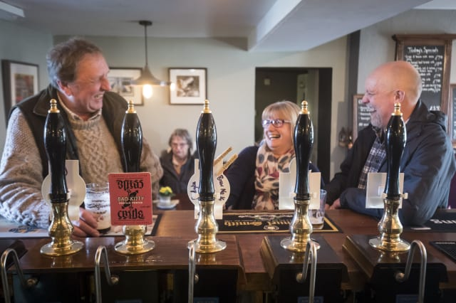 Embargoed to 0001 Friday March 3 Customers at the George and Dragon pub in Hudswell, North Yorkshire, which has been crowned the CAMRA Pub of the Year.