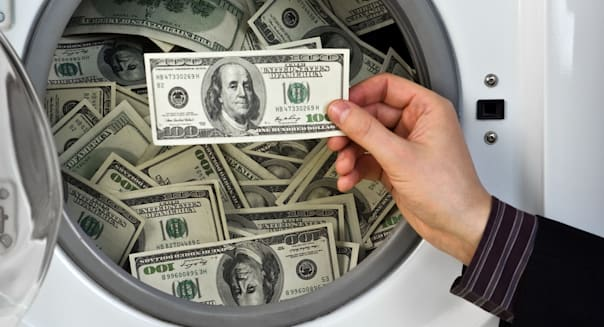money in washing machine close up