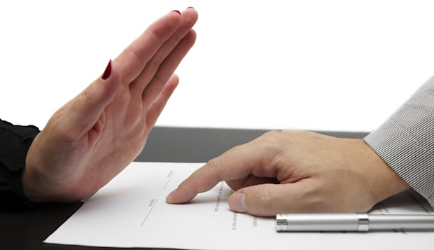 woman refusing to sign contract or divorce