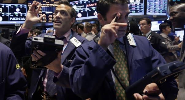 APTOPIX Wall Street (Traders Gregory Rowe, left, and Craig Spector work on the floor of the New York Stock Exchange, Friday, Oct