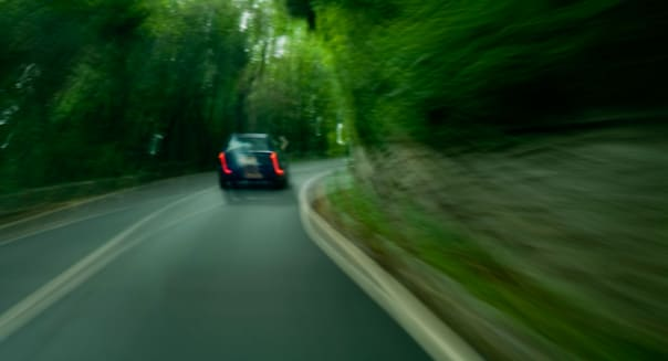 BCATY5 Blurred view of a car speeding down a country road