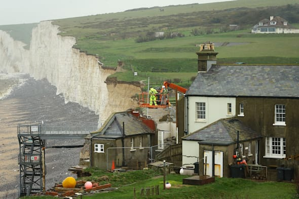 A general view of the cottage at Birling Gap near Eastbourne, East Sussex, as work continues to demolish the property due to the continuing erosion of the cliff edge. PRESS ASSOCIATION Photo. Picture date: Monday April 7, 2014. Photo credit should read: Gareth Fuller/PA Wire