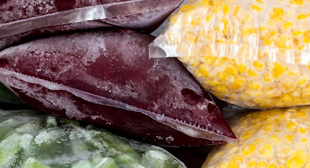 Packed frozen vegetables in freezer.