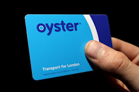 File photo dated 21/09/08 of a hand holding an Oyster pre-pay travelcard. London bus drivers will no longer accept cash payment on board their vehicles when new measures are introduced this summer. PRESS ASSOCIATION Photo. Issue date: Monday February 3, 2014. Transport for London (TfL) has announced a raft of changes, including allowing passengers with insufficient Oyster card credit to travel for a whole journey before they need to top up. See PA story TRANSPORT Oyster. Photo credit should read: Dominic Lipinski/PA Wire