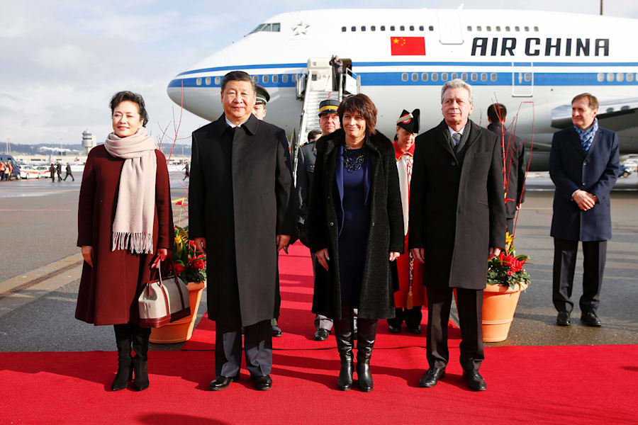 Chinese President Xi Jinping and his wife Peng Liyuan with Swiss President Doris Leuthard and her husband...