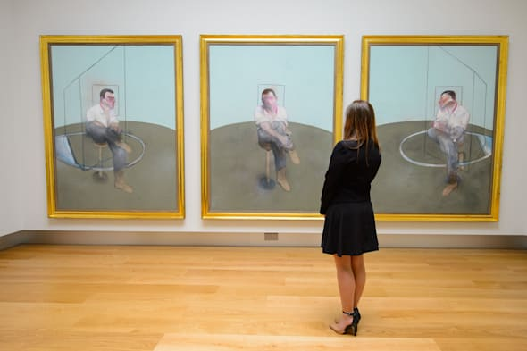 A visitor views the triptych 'Three Studies for a Portrait of John Edwards' by Francis Bacon, which is expected to fetch around 80 million US Dollars as part of Christie's Post-War and Contemporary Art sale in New York on May 12 and 13 2014. PRESS ASSOCIATION Photo. Picture date: Friday April 11, 2014. See PA story SALE Bacon. Photo credit should read: Dominic Lipinski/PA Wire