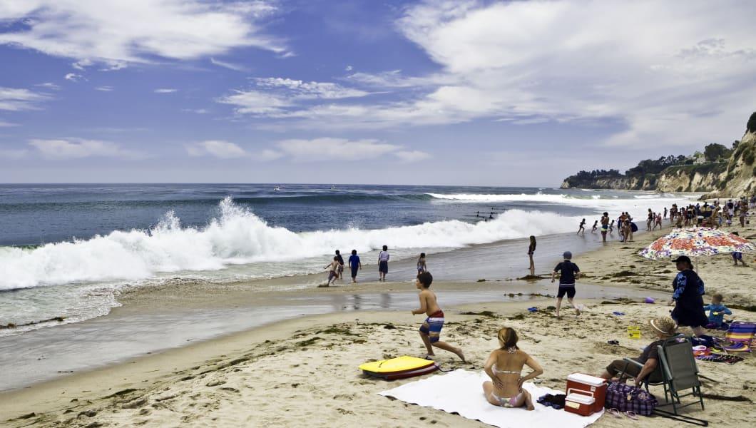 children enjoy surf as wave...