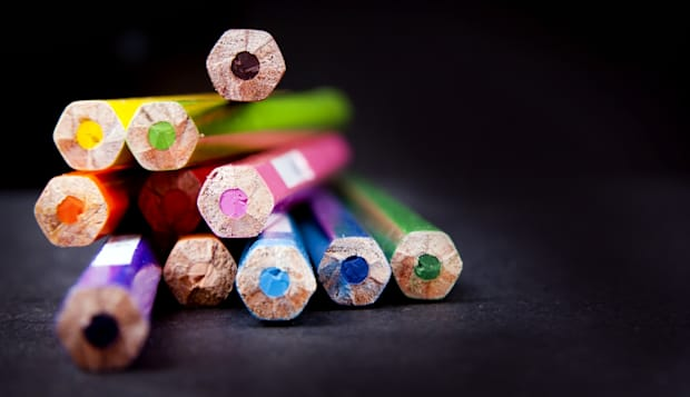 ends of used pencils in a stack ...