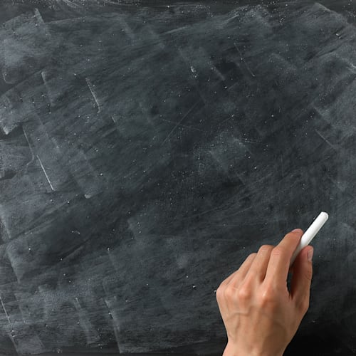 a blank blackboard and chalk ready for your copy or text with hand