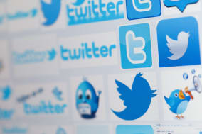File photo dated 10/12/13 of twitter icons as the company has reported a net loss of 645 million dollars (?395 million) for last year. PRESS ASSOCIATION Photo. Issue date: Wednesday February 5, 2014. The popular micro-blogging site, which reported a loss of 8.7 million dollars (?5.3 million) a year earlier, made its market debut on the New York stock exchange in November. See PA story CITY Twitter. Photo credit should read: Chris Ison/PA Wire