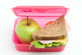 lunch box with sandwich and...
