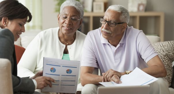 Elderly couple receiving financial consultation