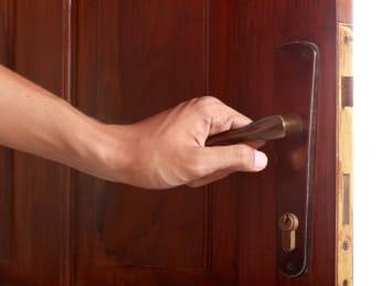 hand open door against white...