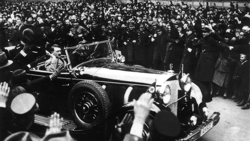 Hitler leaving the Reichstag through the cheering crowd