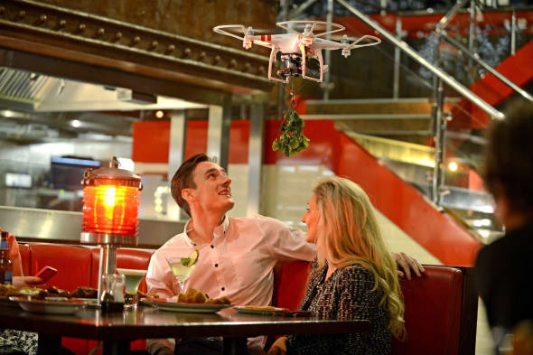 Restaurant launches 'mistletoe drones' to get couples to kiss