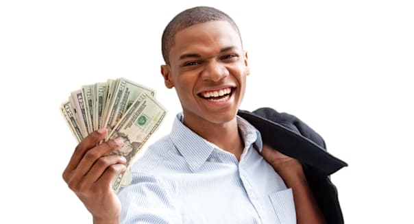 Young African business man standing relaxed and secure with jacket over shoulder and money in hand isolated