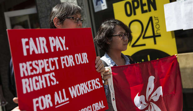 Fast Food Workers Rally And Urge International Workers To Get Involved In Higher Wage Movement