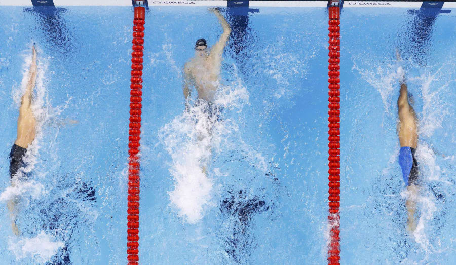 The finish of the men's 100m backstroke. Larkin is out of the picture to the