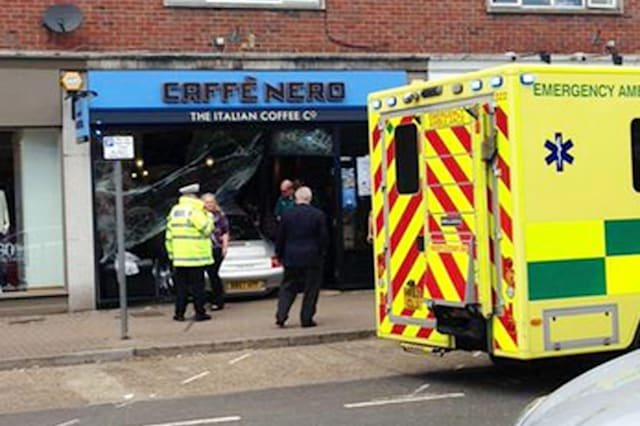 BEST QUALITY AVAILABLEHandout photo courtesy of Jenny Hodge of emergency service at the scene of an accident at the Caffe Nero in Gerrards Cross, Buckinghamshire, this afternoon, after a Porsche crashed into the front of the building. The driver was treated for minor injuries. PRESS ASSOCIATION Photo. Issue date: Saturday May 16, 2015. See PA story ACCIDENT Porsche. Photo credit should read: Jenny Hodge/PA WireNOTE TO EDITORS: This handout photo may only be used in for editorial reporting purposes for the contemporaneous illustration of events, things or the people in the image or facts mentioned in the caption. Reuse of the picture may require further permission from the copyright holder.