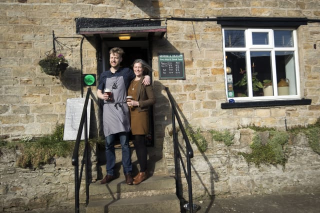 Embargoed to 0001 Friday March 3 Landlord Stuart Miller and his wife Melissa at the George and Dragon pub in Hudswell, North Yorkshire, which has been crowned the CAMRA Pub of the Year.