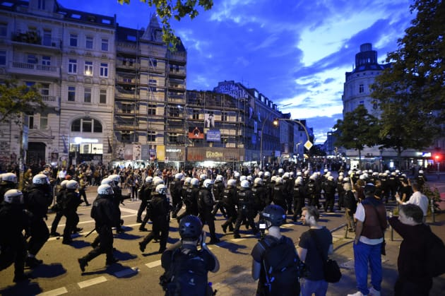 German riot police confront protesters during the demonstration at the G20 summit in Hamburg, Germany...