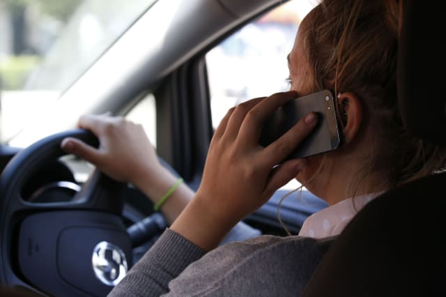 PICTURE POSED BY MODELFile photo dated 13/08/14 of a woman talking on her phone while driving, as nearly 50% of drivers admit breaking traffic laws, with around half of them doing so deliberately, according to a survey. PRESS ASSOCIATION Photo. Issue date: Tuesday April 28, 2015. As many as 49% said they flouted road regulations, the poll from road safety charity Brake and insurance company Direct Line showed. See PA story TRANSPORT Laws. Photo credit should read: Jonathan Brady/PA Wire