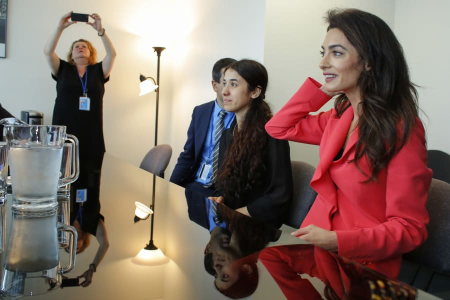 Amal Clooney (R) attends a meeting with French Foreign minister Jean-Marc Ayrault at the UN Headquarters...