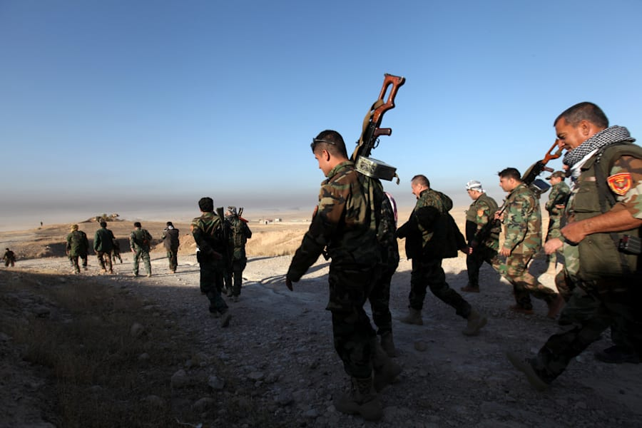 Peshmerga forces walk in the east of Mosul during operation to attack Islamic State militants in Mosul,...