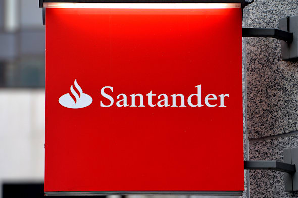 File photo dated 19/02/14 of a Santander bank sign in Victoria, central London as the high street lender has been fined ?12.4 million after the City watchdog uncovered