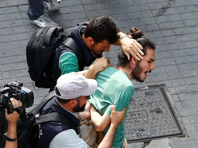 Plainclothes police officers detain LGBT rights activists as they try to gather for a pride parade in...