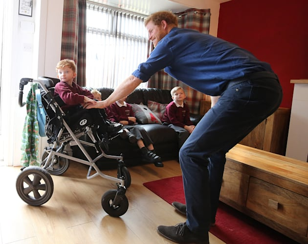 Prince Harry meets Oliver Rooney (L), who has Wolf Hirschhorn Syndrome. (Photo by Nigel Roddis/Getty