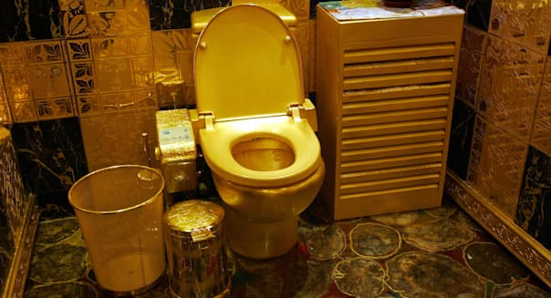 HONG KONG, CHINA:  This picture taken in Hong Kong 24 February 2005 shows a solid gold and gem-encrusted toilet valued at 38,000,000 million Hong Kong dollars (4.8 million USD).  The Hong Kong tourism board has removed the gold jewellery store that displays the toilet from its preffered list after staff were rude to customers.     AFP PHOTO/MIKE CLARKE  (Photo credit should read MIKE CLARKE/AFP/Getty Images)
