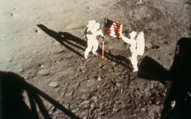 Astronauts Armstrong and Aldrin unfurling the US flag on the Moon, 1969.