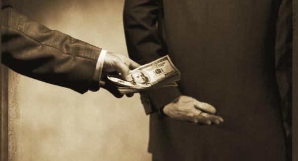 Men secretively passing money