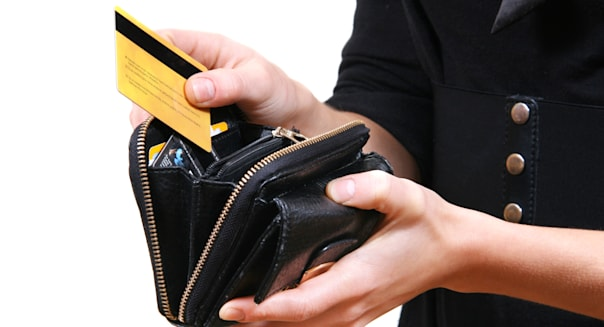 woman taking credit card out of ...