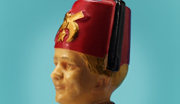 Plastic Man Wearing Fez