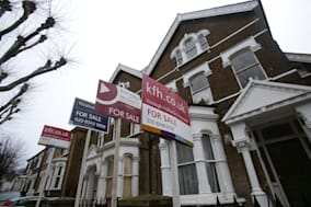 File photo dated 27/1/2014 of For Sale signs displayed outside houses in Finsbury Park, north London. Experts are warning that stronger curbs must be considered for the housing market amid fears that London is starting to show