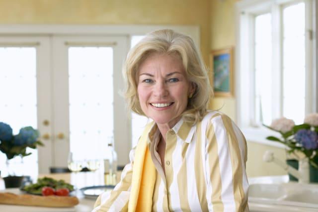 BXAR81 Senior Woman in Her Kitchen Senior|Woman|Kitchen; |Optimism|Smiling|65-70; years|70s; adult|Senior; woman|Whites|Kitchen|