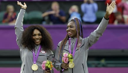 London Olympics Tennis Women (Serena Williams, left, and Venus Williams of the United States smile wave from the podium after re