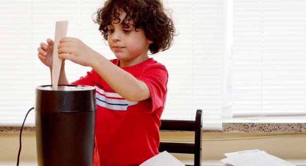 A boy shredding personal info