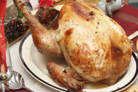 festivals, religious, christmas, food cooked poultry. a whole turkey ready for carving on a table laid for christmas lunch....