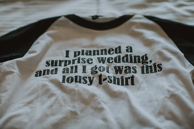 The matching T-shirts the couple gave their wedding party at the rehearsal dinner, which was a hotel...