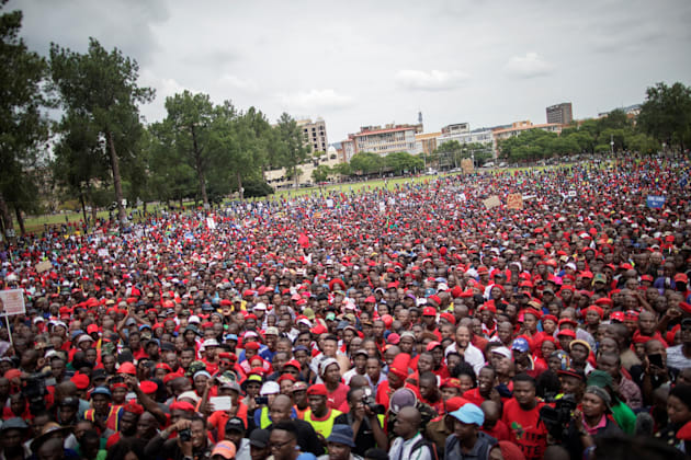 Tens of thousands of opposition parties and civil society organization members take part in a march to...