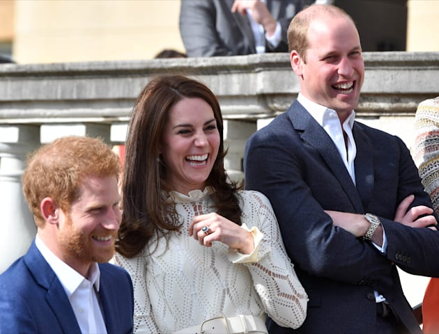 Prince Harry, Catherine, Duchess of Cambridge and Prince William, Duke of Cambridge laugh as they host...