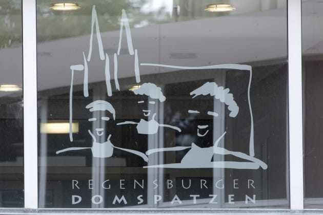 This Oct. 12, 2016 file photo shows the logo of the Regensburger Domspatzen choir at a window of the...