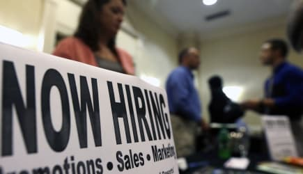 Economy (In this Thursday, Oct. 25, 2012, photo, a sign attracts job-seekers during a job fair at the Marriott Hotel in Colonie,