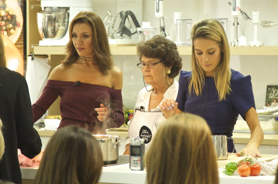 Poppy Stamateris and her sister Marika Gouveros support the launch of their mum Mary Mitropoulos' cookbook,...