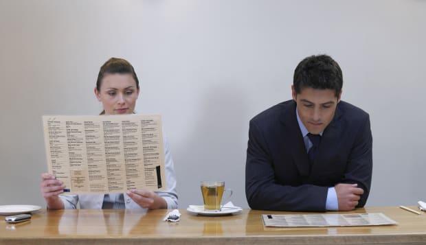 Office workers looking at menus