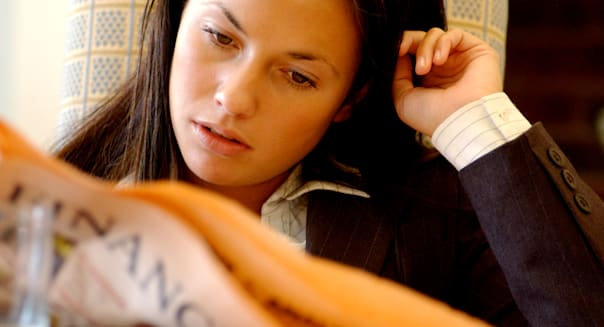 A45A9G Royalty free photograph of young British business graduate reading Financial Times London UK  credit; crunch; ft; young;