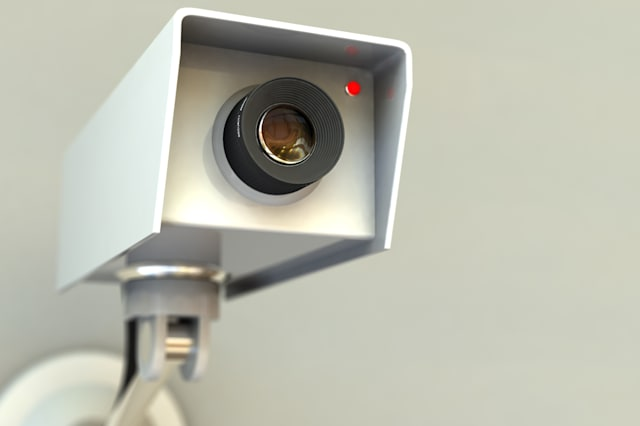 A close view of a closed circuit television security camera. 3D rendering with raytraced textures and HDRI lighting.Other images